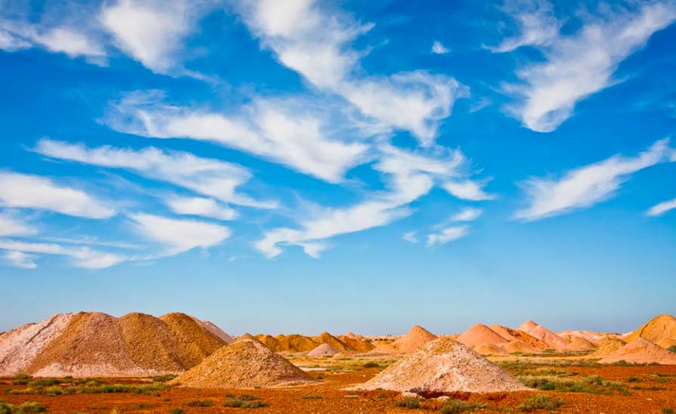 Mullock Heaps, the leftover residual dirt from the opal mining process, which may contain small pieces of opal fragments that were missed by the miners, is a popular spot for locals and tourists. Photo: Courtesy of South Cape Photography / District Counci