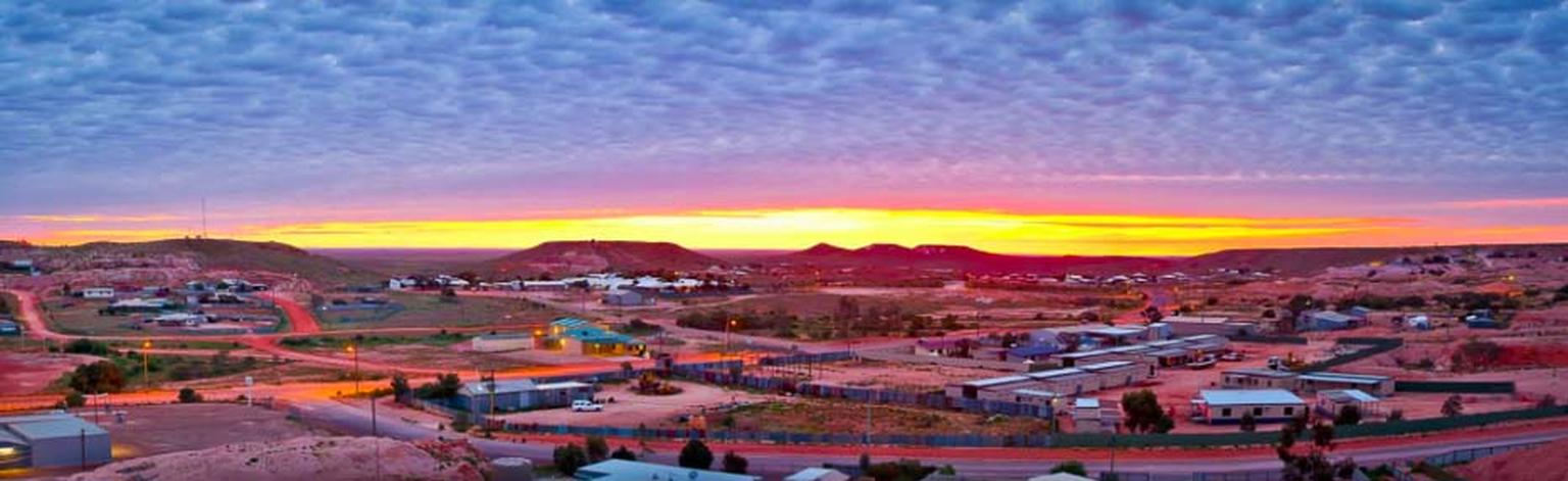 Sunrise over the town of Coober Pedy, known as the opal capital of the world, which provided the backdrop for the 1985 movie Mad Max: Beyond the Thunderdome. Photo: Courtesy of South Cape Photography / District Council of Coober Pedy.