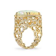 A side view of the intricate goldwork on Erica Courtney's ring, set with a Coober Pedy opal.