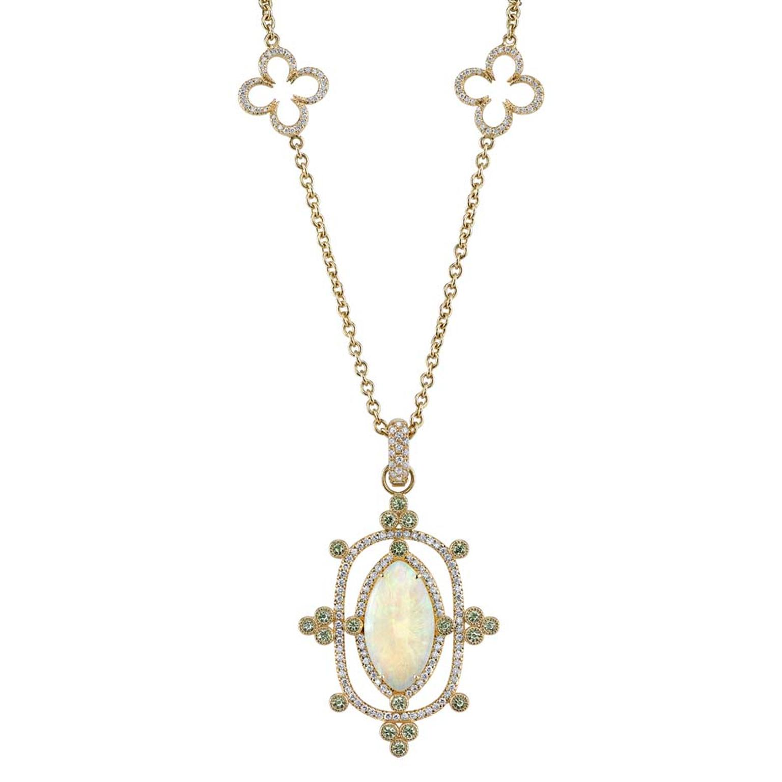 Erica Courtney Interstellar Opal pendant on a Buff Clover chain necklace. The 5.12ct Coober Pedy opal is highlighted by diamonds and demantoid garnets, and hangs from a yellow gold chain.
