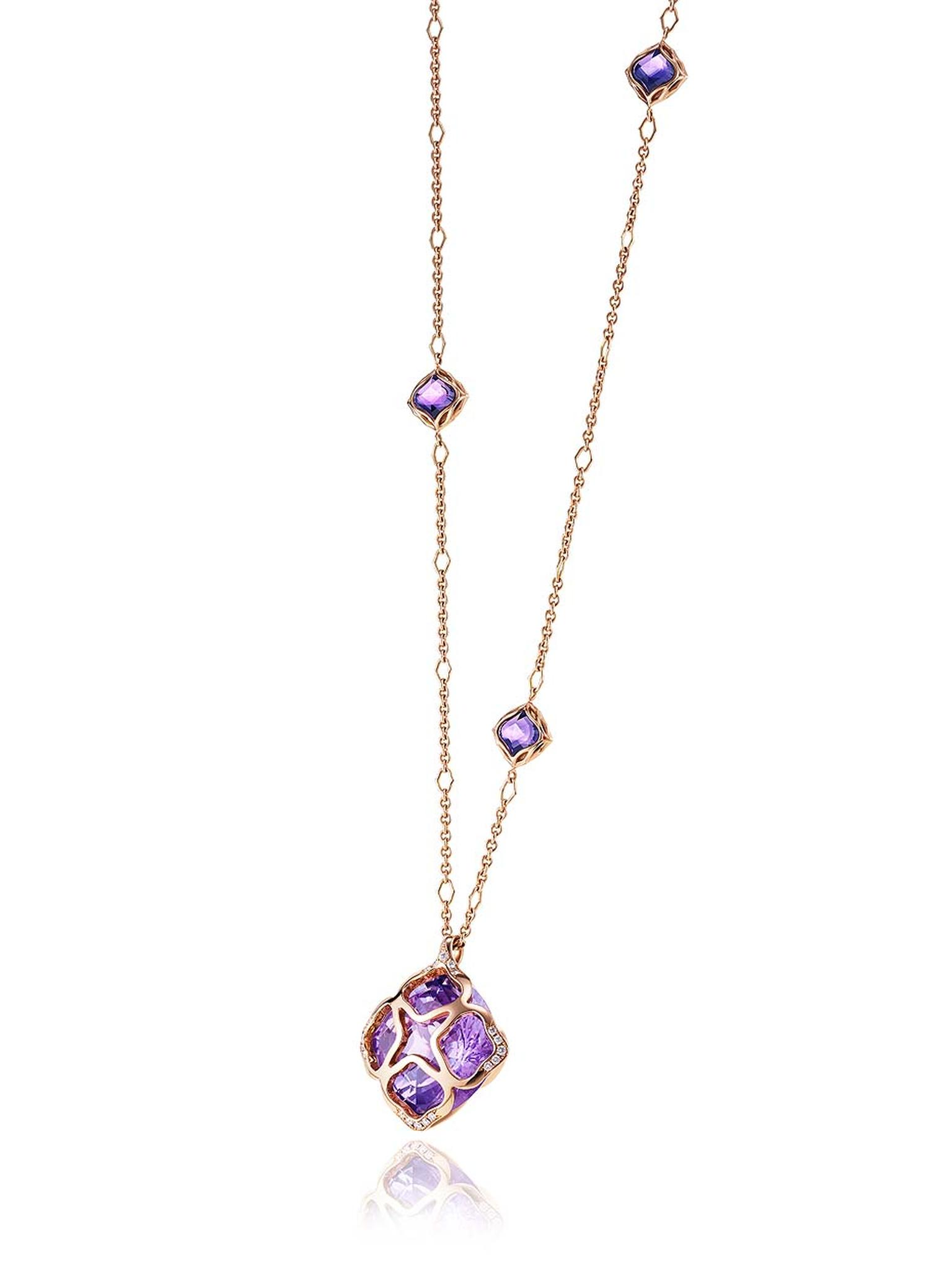 This Chopard jewellery pendant from the Imperiale high jewellery collection features a sparkling 48ct amethyst in a gold cage on the end of a long 18ct white or rose gold chain.