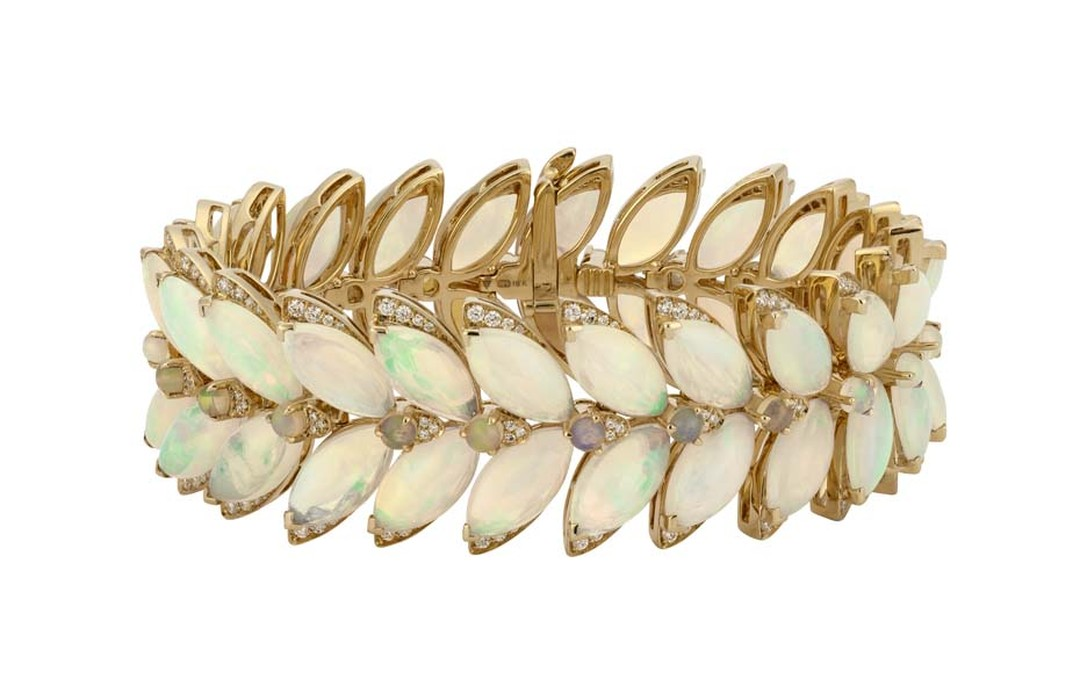 Stephen Webster Magnipheasant Feathers white opal bracelet in yellow gold with diamonds.