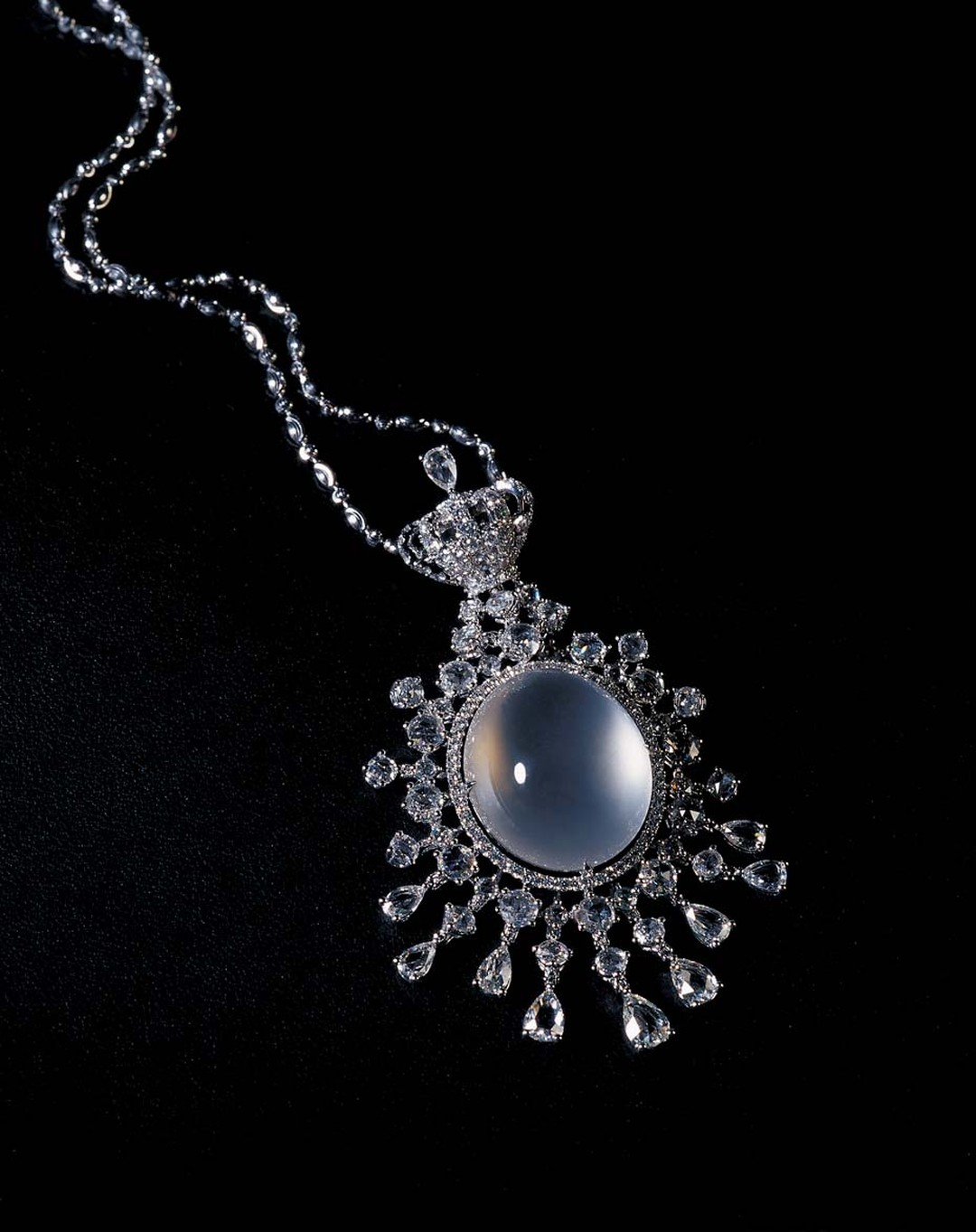 Colourless icy jadeite pendant necklace with diamonds.