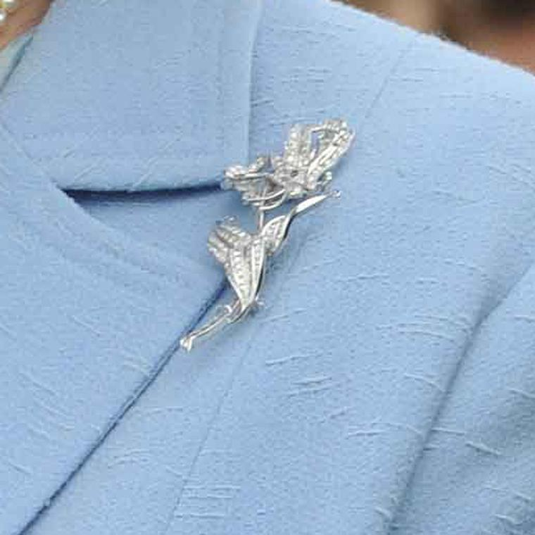 Close up the Queen's diamond flame lily brooch