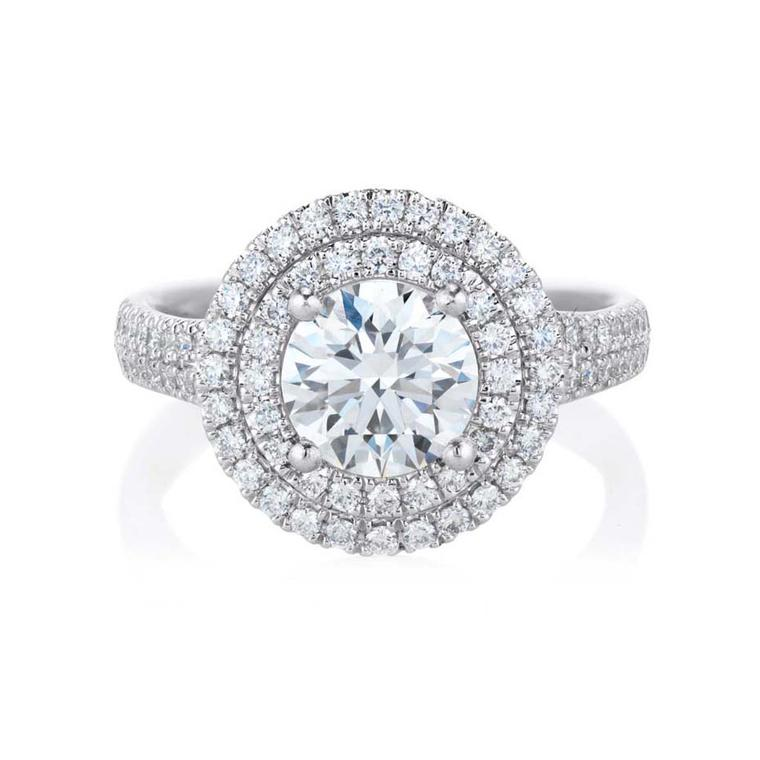 De Beers Aura Double Halo ring in platinum, set with a central round, brilliant-cut diamond and micro pavé diamonds.