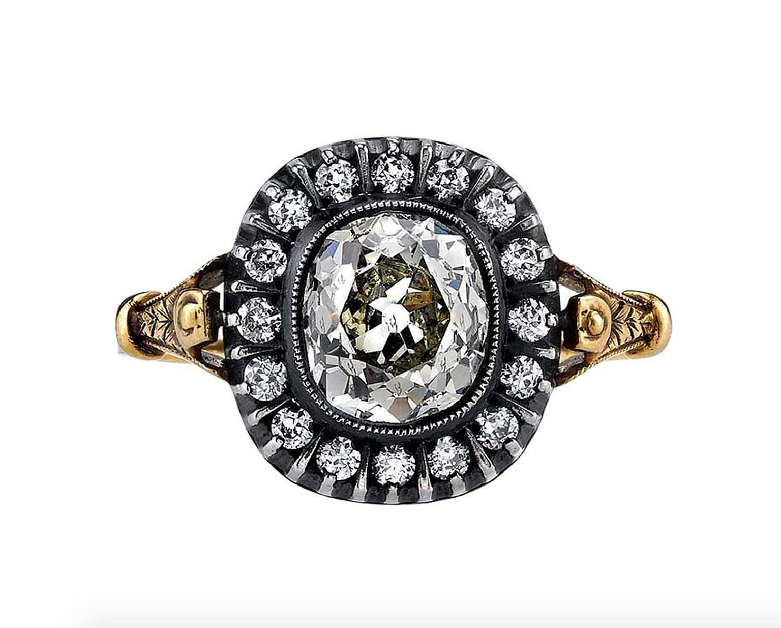 A classic Victorian design, this antique engagement ring features a cushion-cut diamond set in a handcrafted, oxidised, yellow gold and silver mounting, surrounded by a halo of diamonds. Available from 1stdibs.com.
