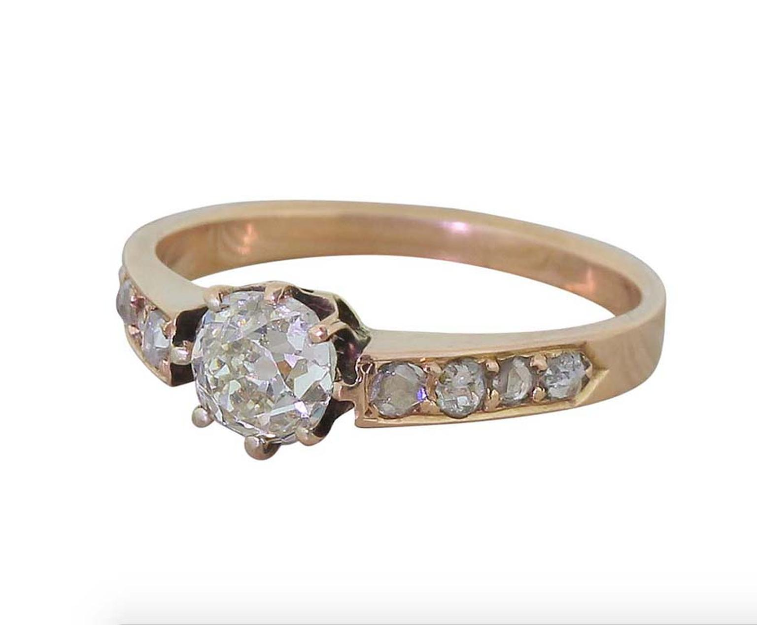This Victorian engagement ring in rose gold is set with four rose-cut diamonds on either side of the central solitaire. Available at 1stdibs.com.