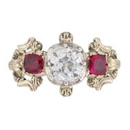Bentley & Skinner three stone Victorian engagement ring with an old brilliant-cut diamond at its centre and two cushion-shaped rubies on either side. It dates from around 1850.