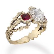A side view of Bentley & Skinner's diamond and ruby Victorian engagement ring, circa 1850.