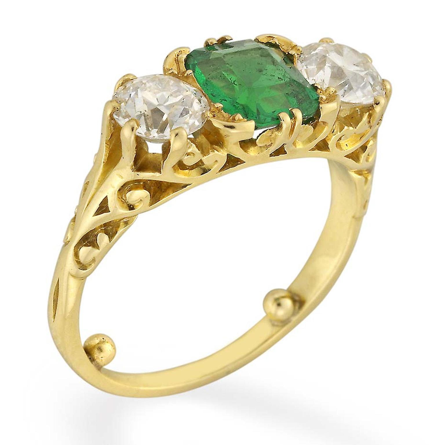 A side view of the Bentley & Skinner emerald and diamond Victorian engagement ring, circa 1880.