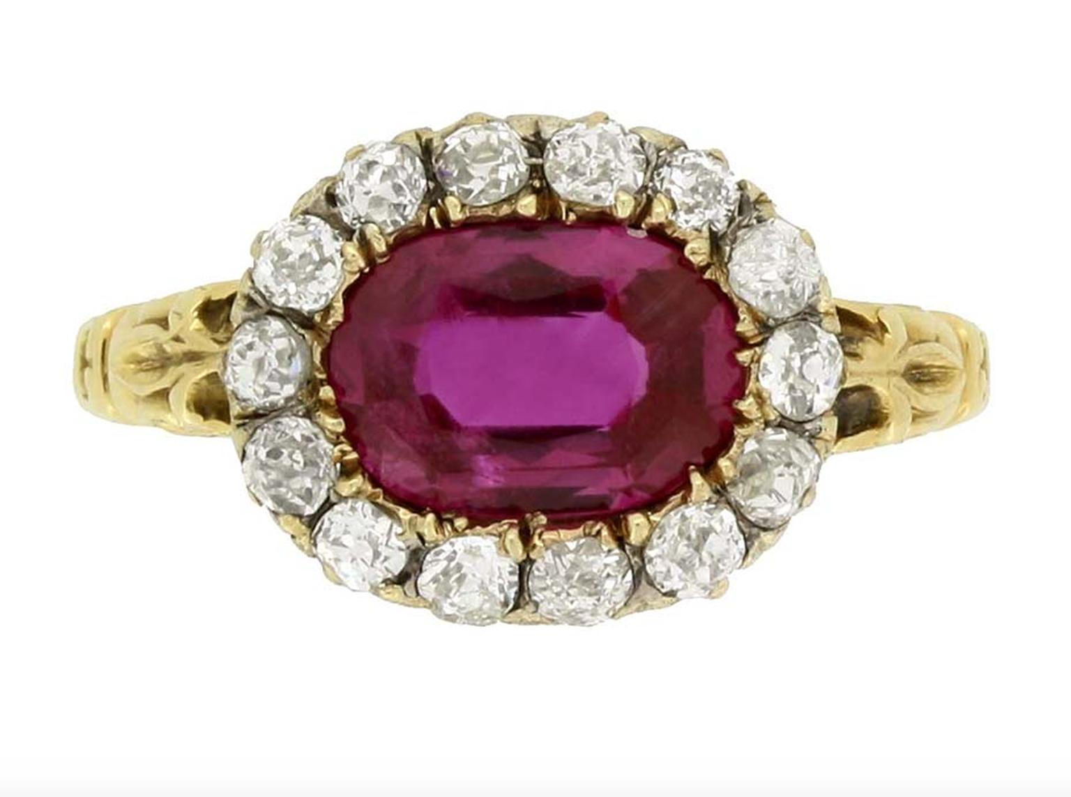 This early Victorian engagement ring, available from Berganza in London, features an oval, old-cut, natural, unenhanced Burmese ruby, encircled by a row of cushion-shape, old-cut diamonds. It dates from around 1850.