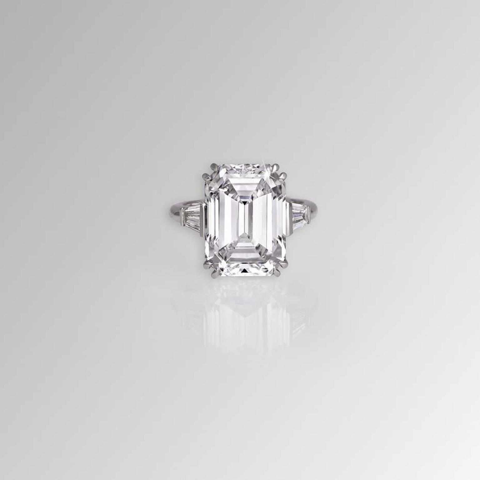 David Morris emerald cut white diamond ring with tapered baguette shoulders, set in 18ct white gold.