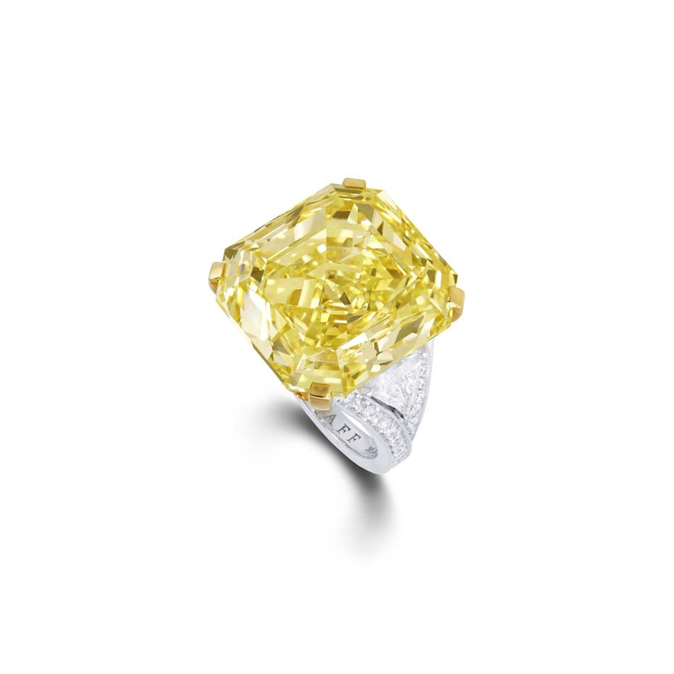 A striking 36.23ct emerald-cut Fancy Intense yellow diamond ring from Graff with brilliant diamond shoulders, set in platinum.