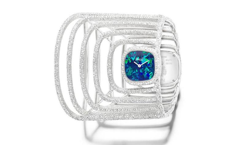 Extremely Piaget watch cuff in white gold with diamonds and an opal dial.
