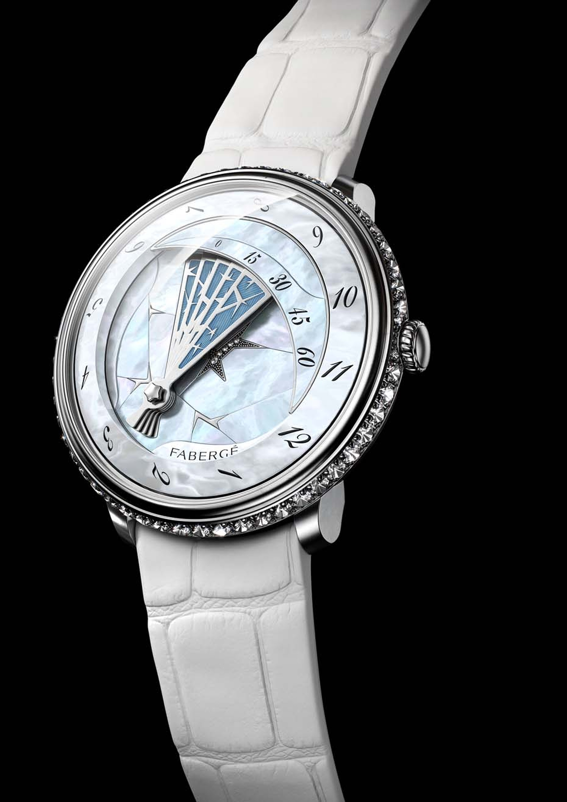 Fabergé's Winter watch, from its new Lady Compliquée collection, pays homage to the famous Fabergé Winter Egg of 1913. The unfolding fan of frost, complete with a blue enamel sky background, covers the dial on the hour and retreats again to reveal the cra