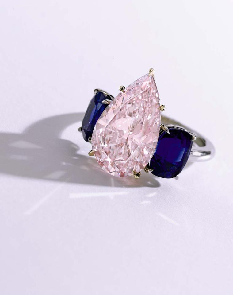 Pink diamond and sapphire ring set with an unmodified pear-shaped Fancy purplish pink 6.24ct diamond and two cushion-cut Kashmir sapphires in gold and platinum. It sold for $2.4 million at Sotheby's Auction of Magnificent Jewels on 21 April.