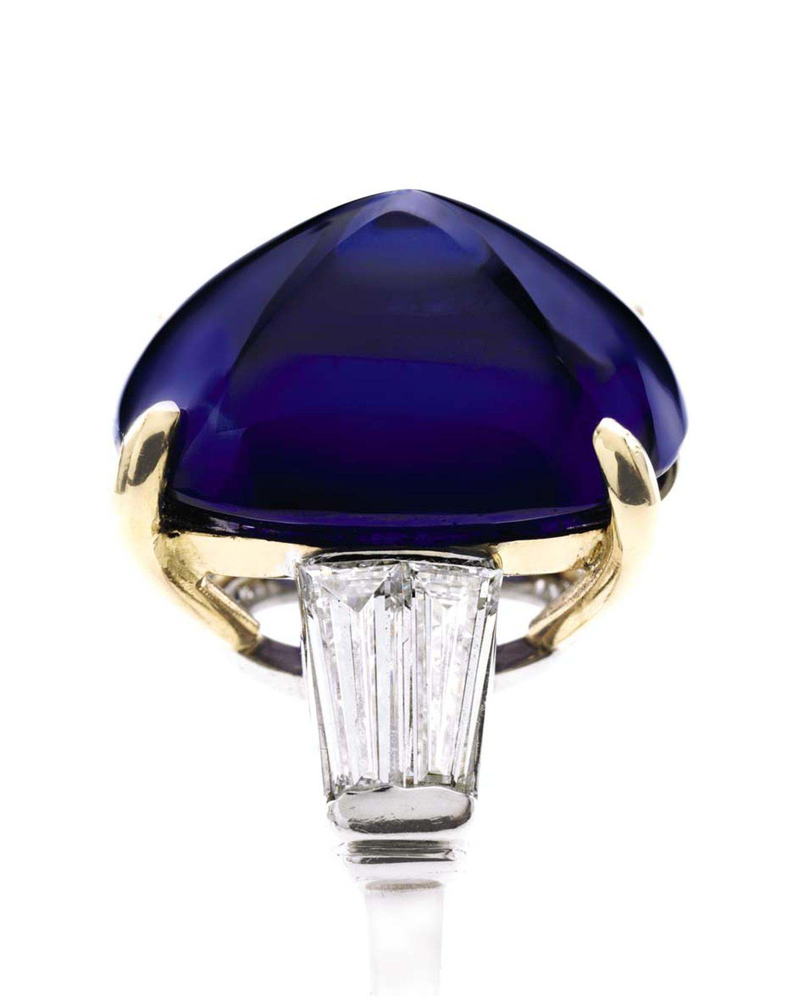 Important platinum and gold ring set with a 9.94ct sugarloaf cabochon sapphire, accompanied by diamonds on each shoulder (estimate: $700,000-$1 million).