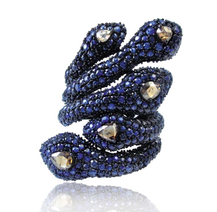 Sutra snake ring in black gold with 5ct of sapphires and diamonds.