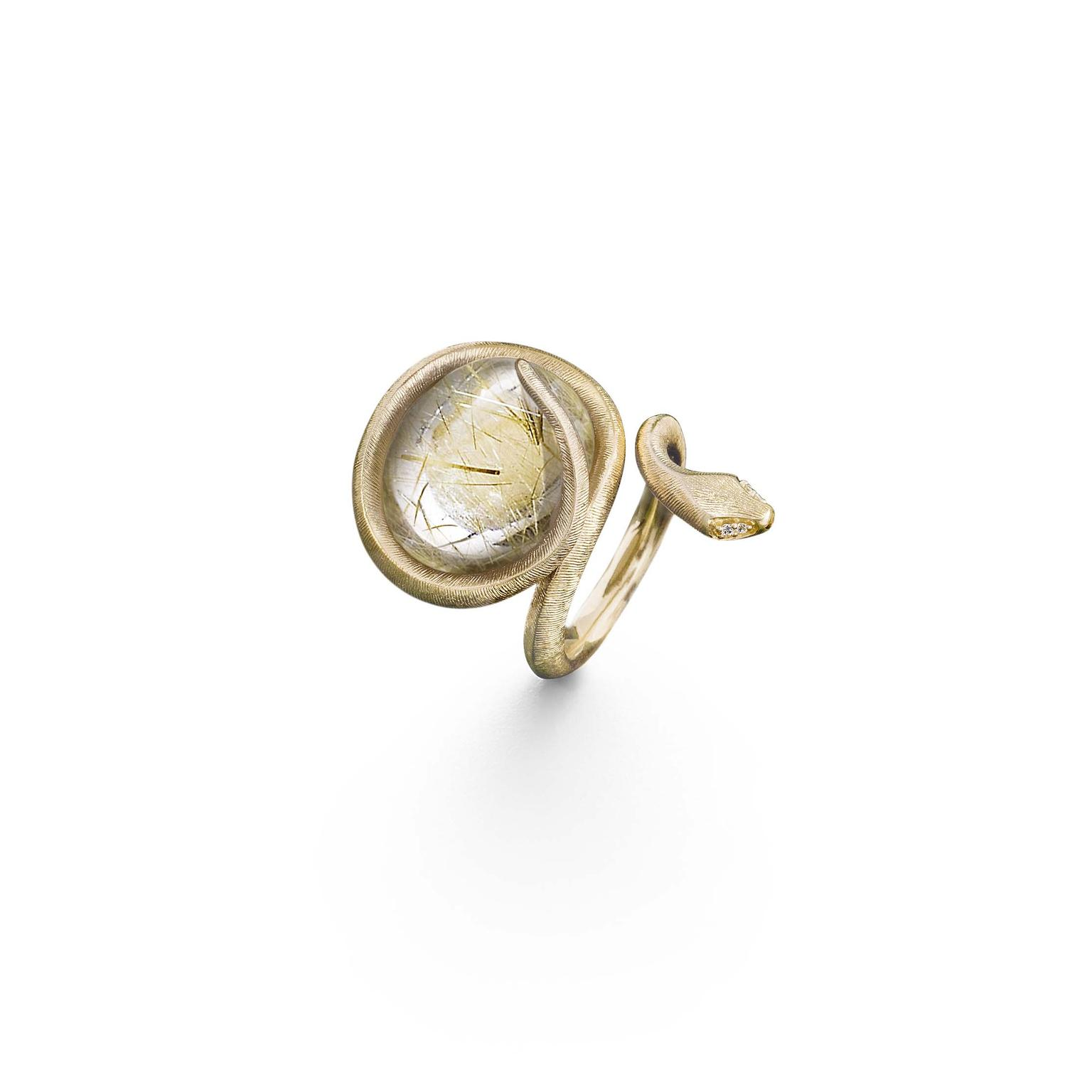 Ole Lynggaard yellow gold ring, set with a rutilated quartz and four diamonds for eyes.
