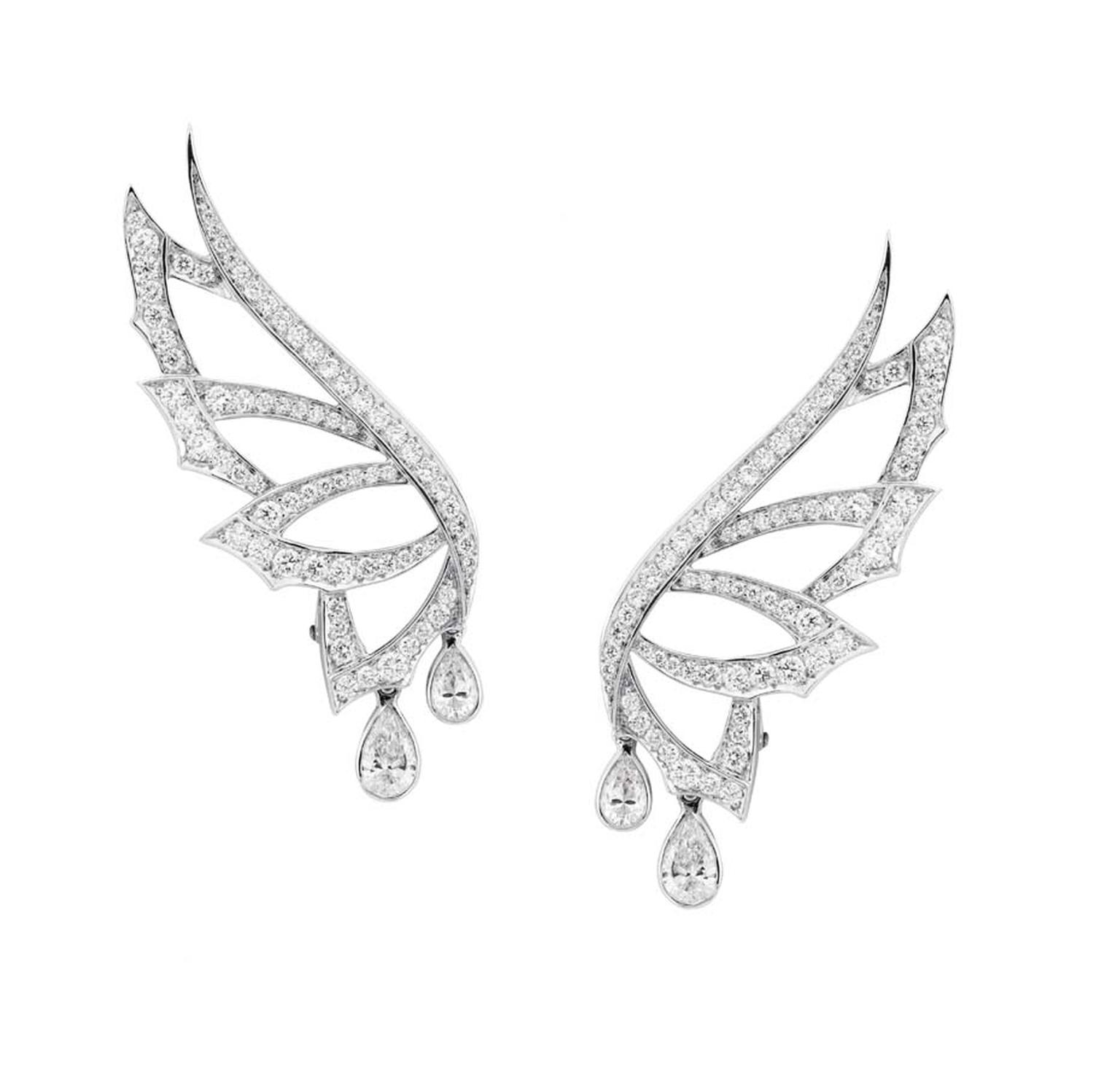 Stephen Webster ear climbers in white gold from the Magnipheasant collection with pear-shaped and round white diamonds.