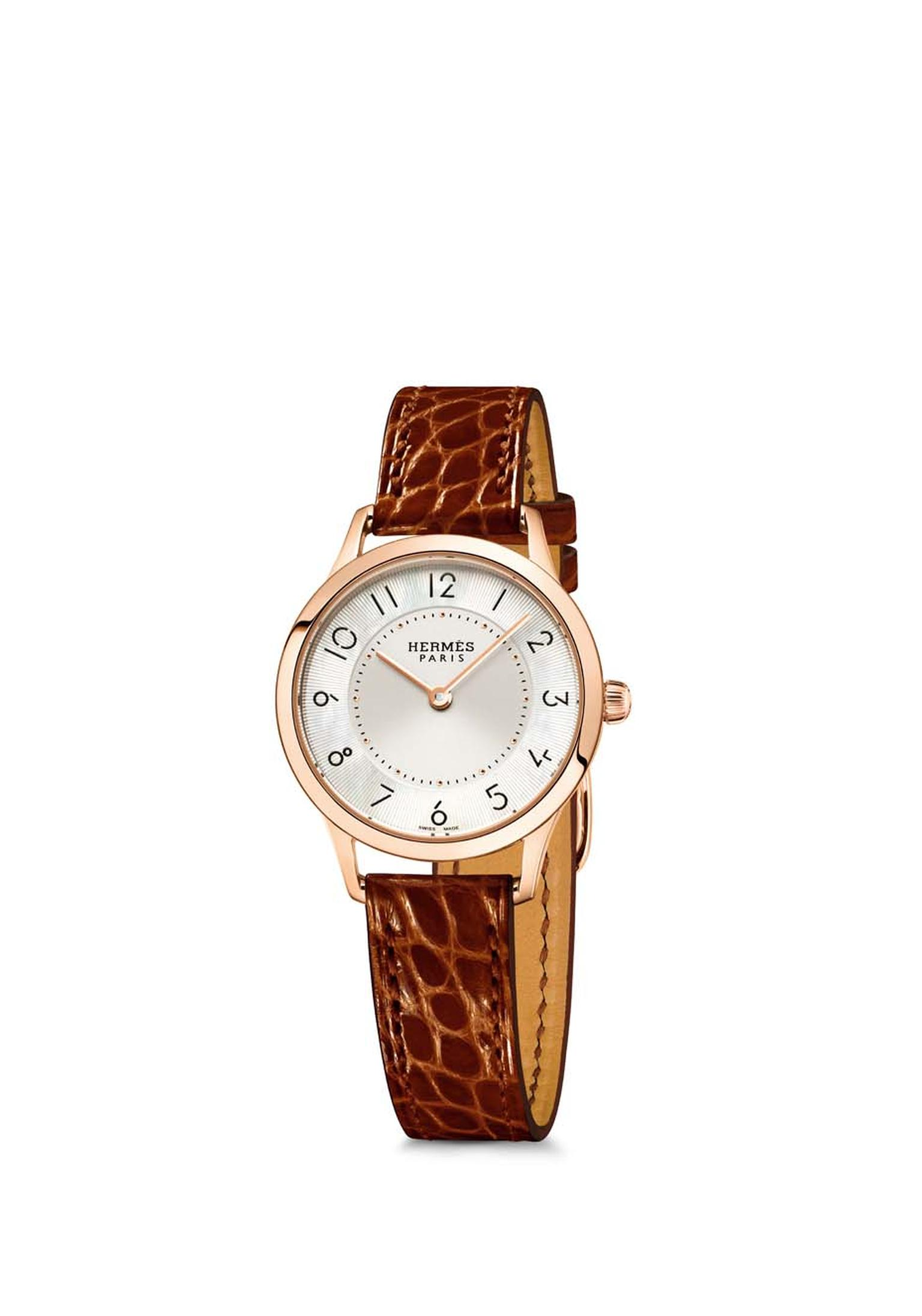 Slim d'Hermès watch in a 25mm rose gold case, also available with a diamond-set bezel. The 25mm model has a Swiss quartz movement.