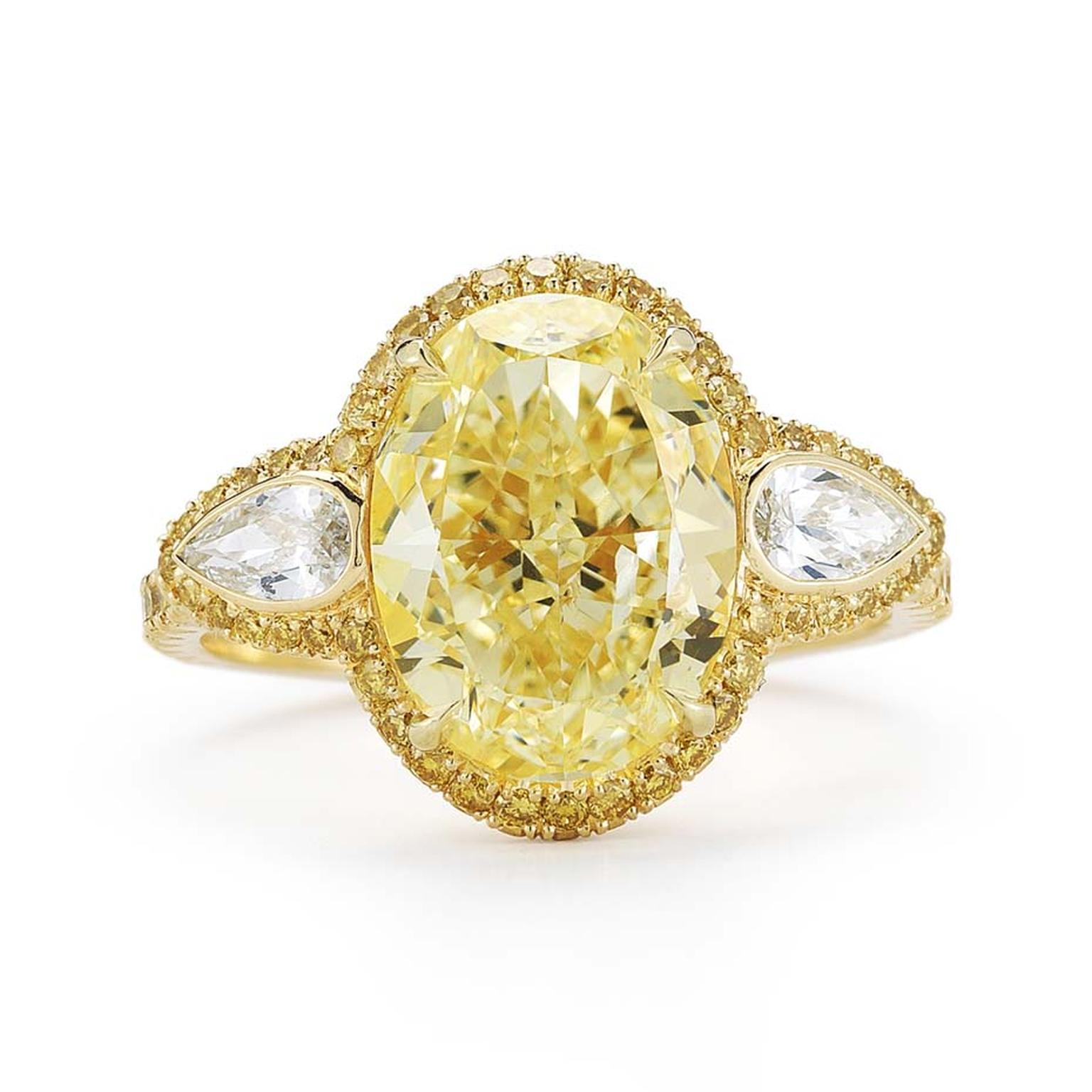 Kwiat oval-cut yellow diamond engagement ring in yellow gold, set with a 4.01ct Fancy light yellow diamond with bezel-set pear side stones and a yellow diamond pavé halo.