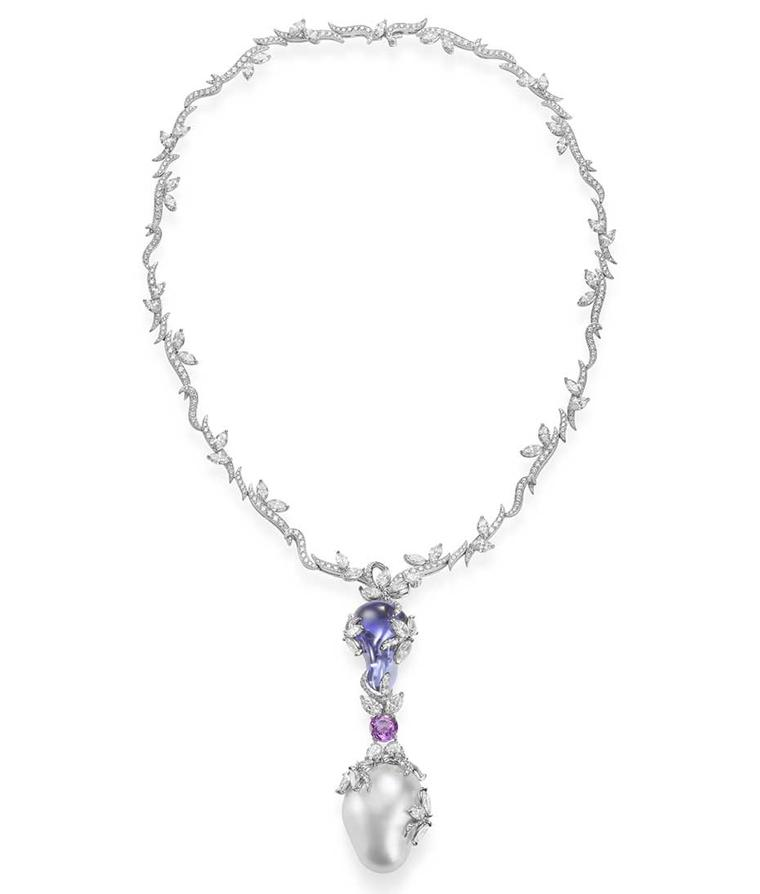 A perfectly smooth yet organically shaped drop, referred to as tumbled tanzanite, complements the wild beauty of a 22mm baroque South Sea pearl in this Mikimoto Hyacinthia necklace.
