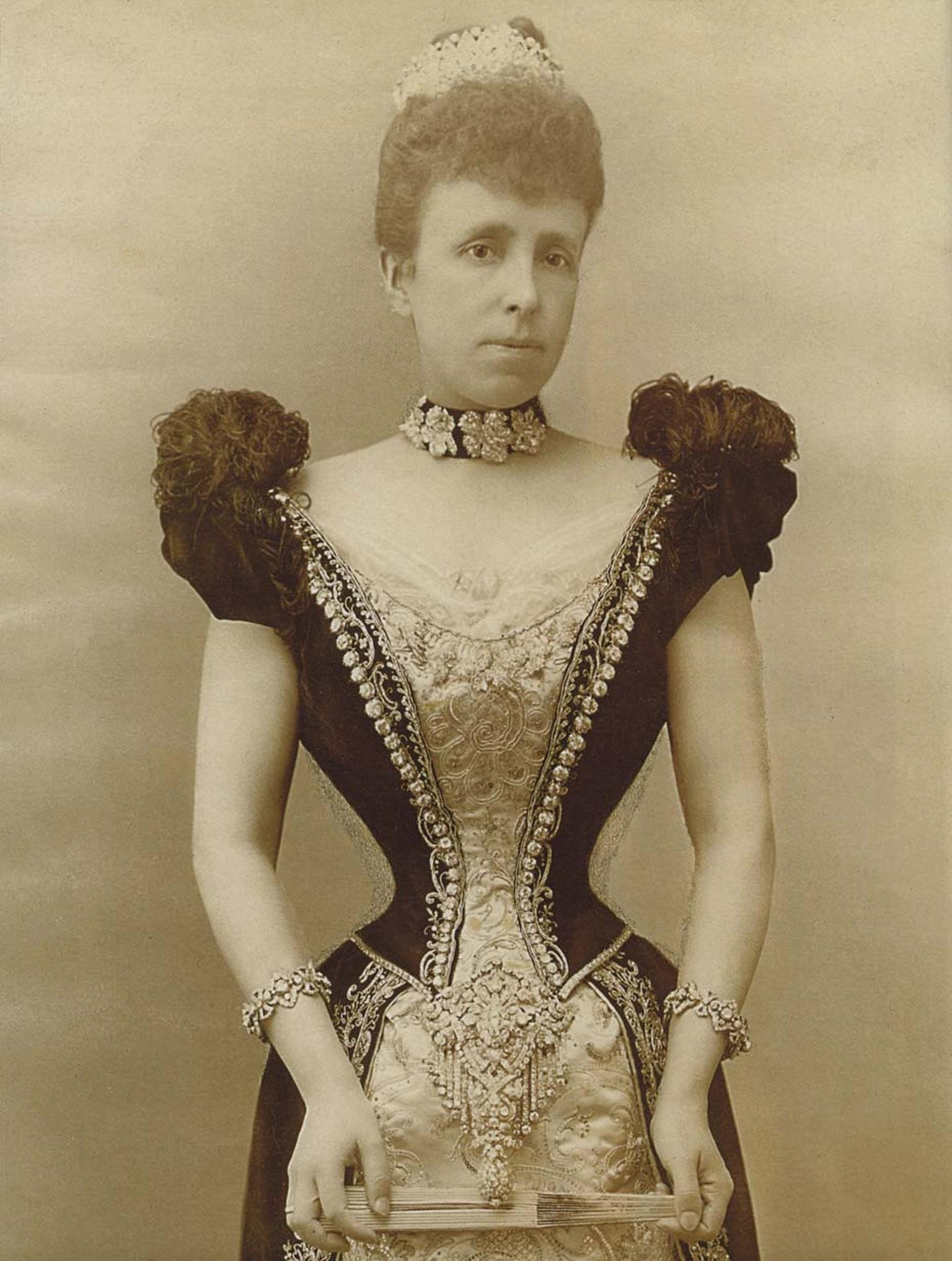The Archduchess Maria Christina of Austria pictured in 1879 wearing the Maria Christina Royal Devant-de-Corsage diamond brooch, which was given to her as a wedding present by King Alfonso XII of Spain.