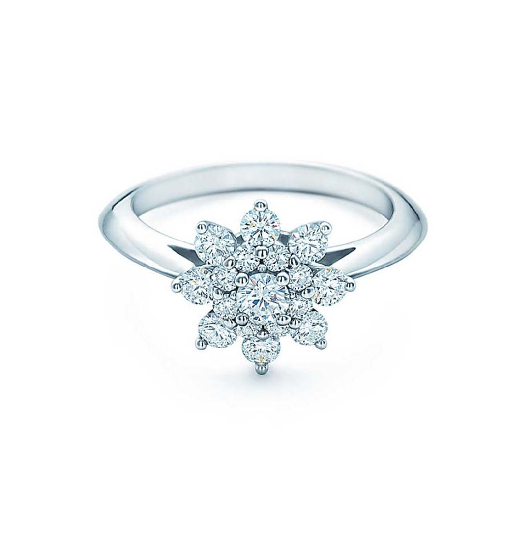 Tiffany & Co. Flower engagement ring, with petals of round brilliant diamonds surrounding a centre diamond.