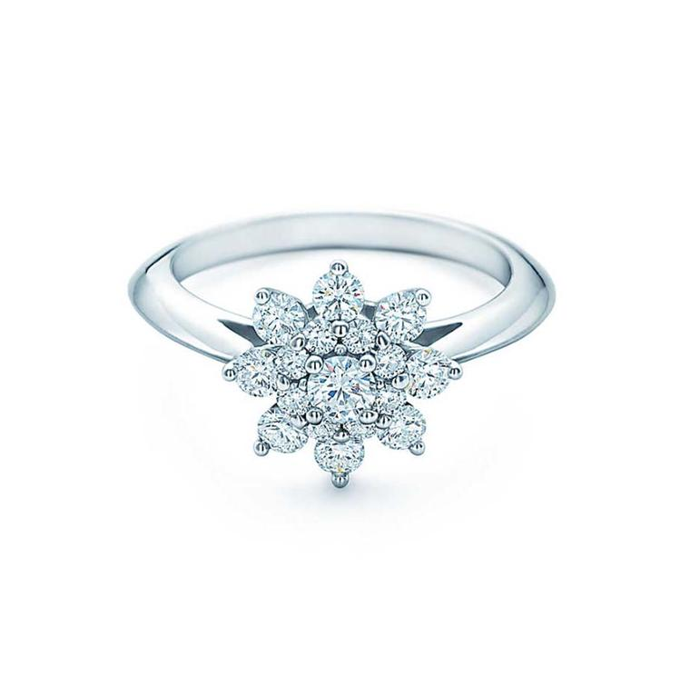 Flower Engagement Ring With Petals Of Round Brilliant Diamonds Surrounding A