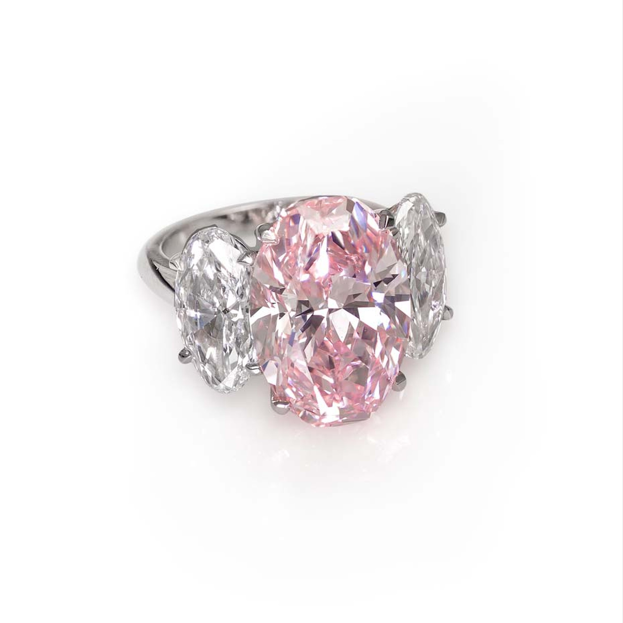 David Morris 10.11ct fancy pink flawless oval diamond ring, mounted in platinum, with 2ct each oval diamond shoulder stones.