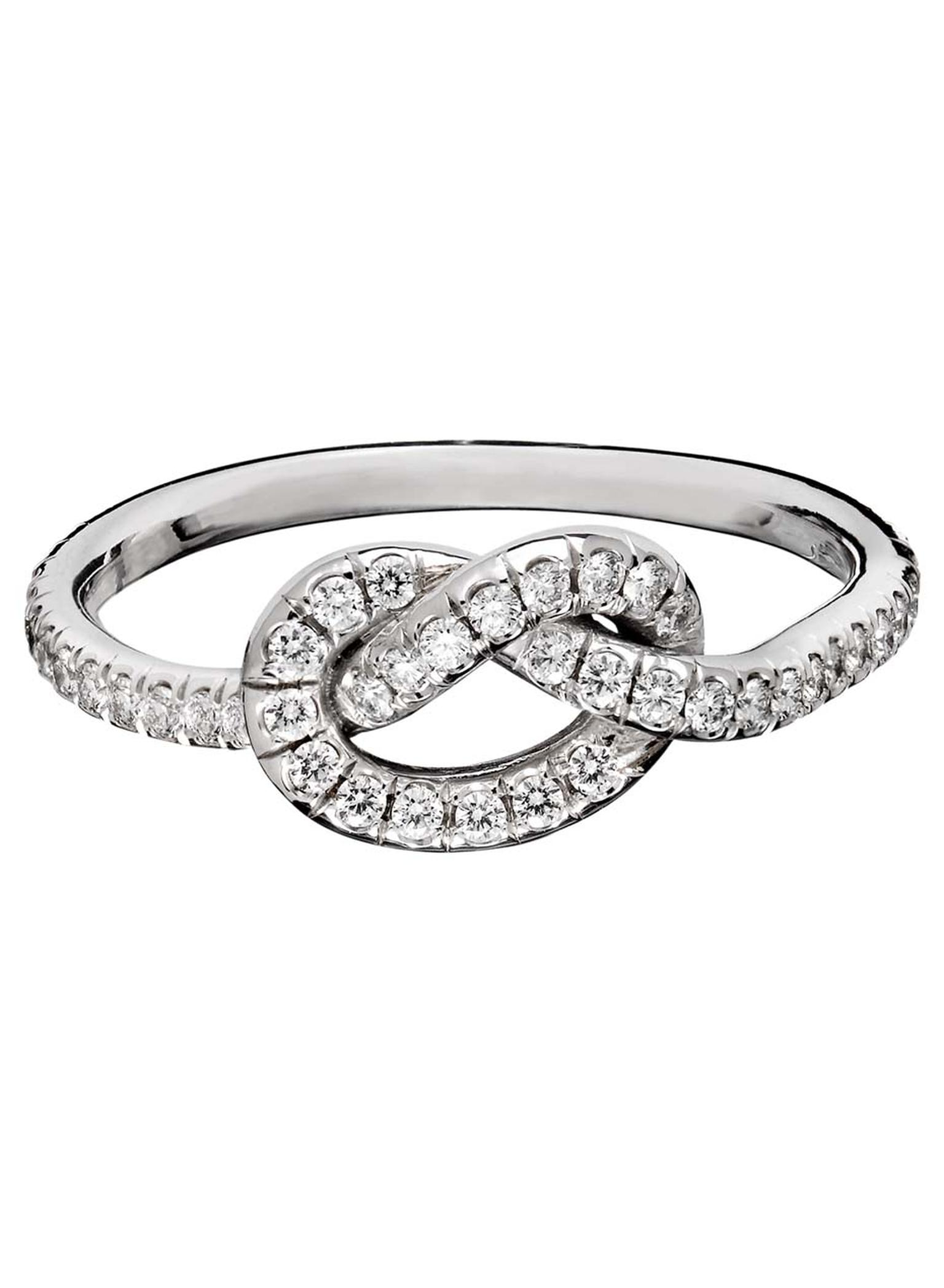 This is the large version of the signature Love Knot ring in white gold, set with 0.57ct of pavé diamonds from Finn Jewelry.