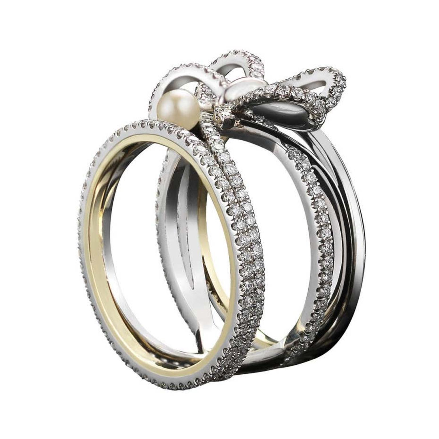 Diamond Bow and Pearl ring by Alexandra Mor jewelry with the designer's signature 1mm knife-edged wire, set in platinum around inner bands of yellow gold.