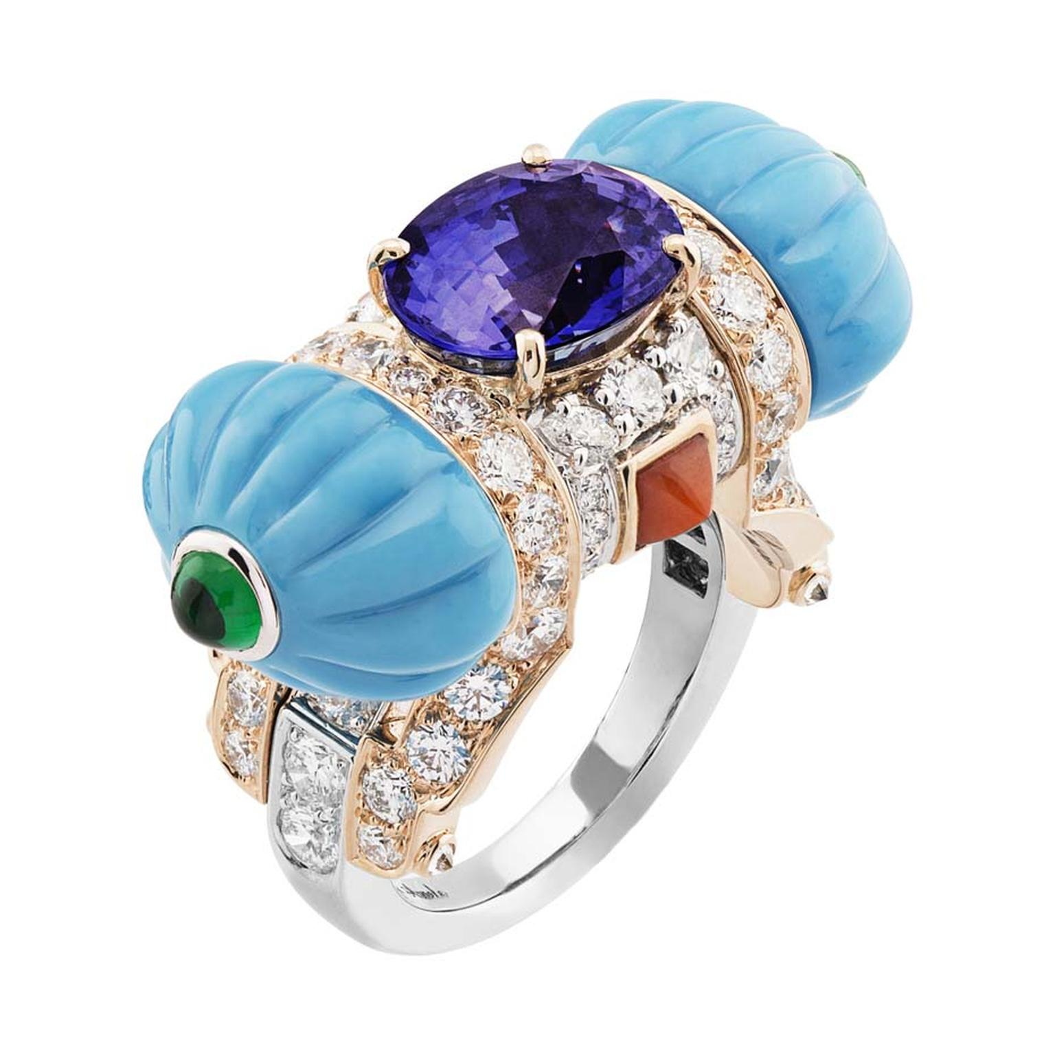 The Cadeau d'Orient white and pink gold ring with turquoise, coral, emeralds, diamonds and a centrally set oval cut purple sapphire.