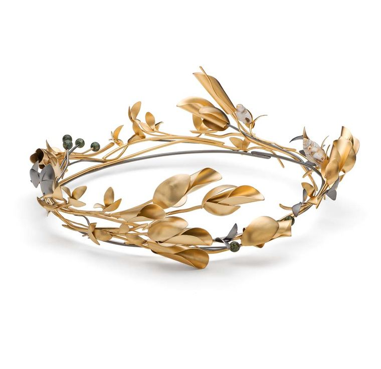 "The phrase ""blasted heath"" used to describe the windswept trees along the coastline of Cornwall inspired this Mirri Damer crown, set with tiny shells and Serpentine - a Cornish semi-precious stone."