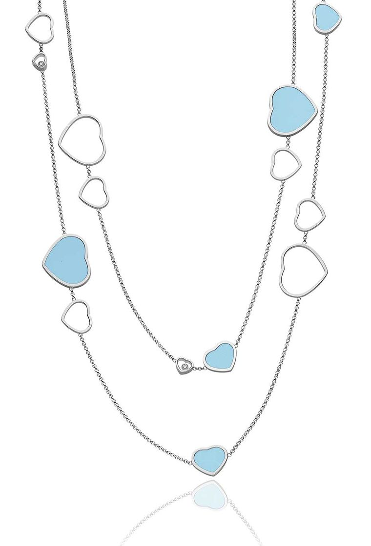 Chopard Happy Hearts necklace in white gold with turquoise and mobile diamonds dotted along the chain.