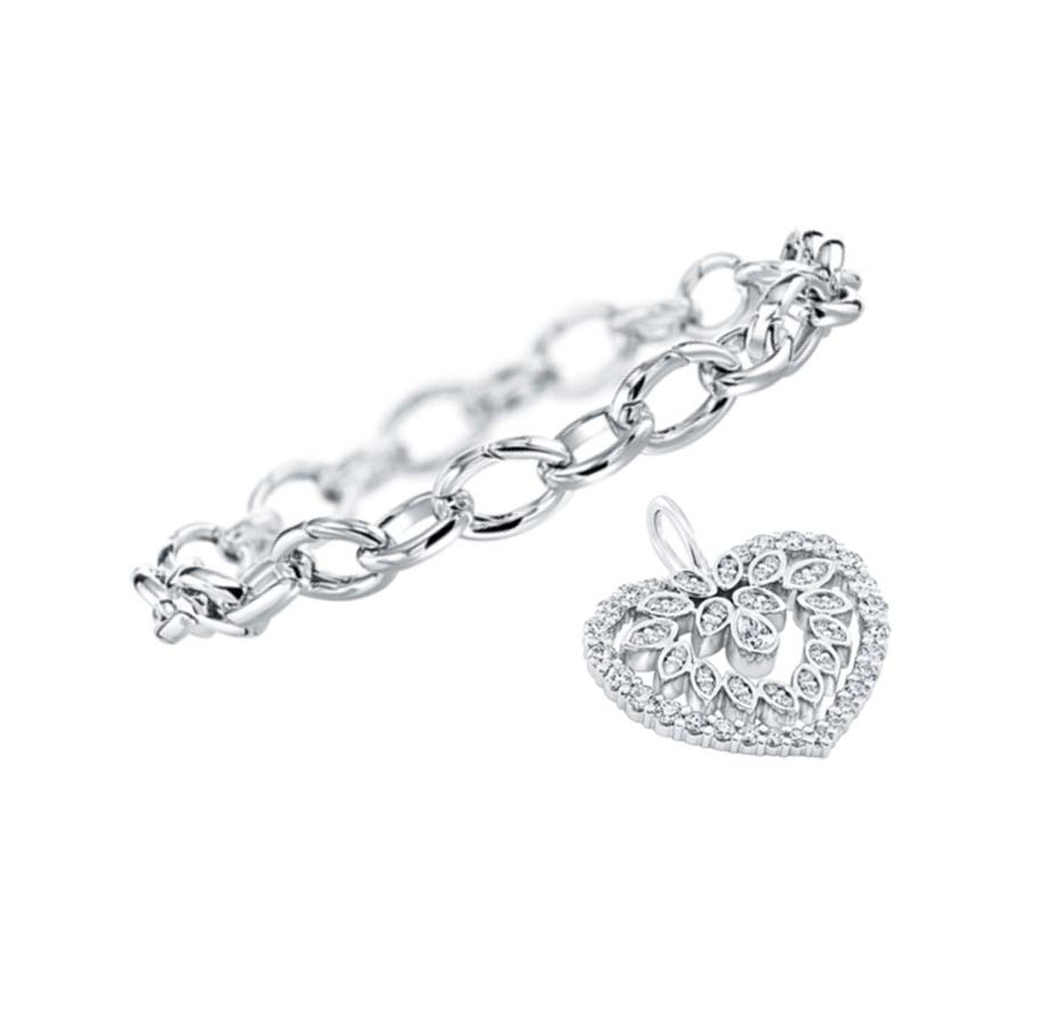 Harry Winston platinum link bracelet and diamond cluster heart, with 60 pear-shaped and round brilliant diamonds set in platinum.