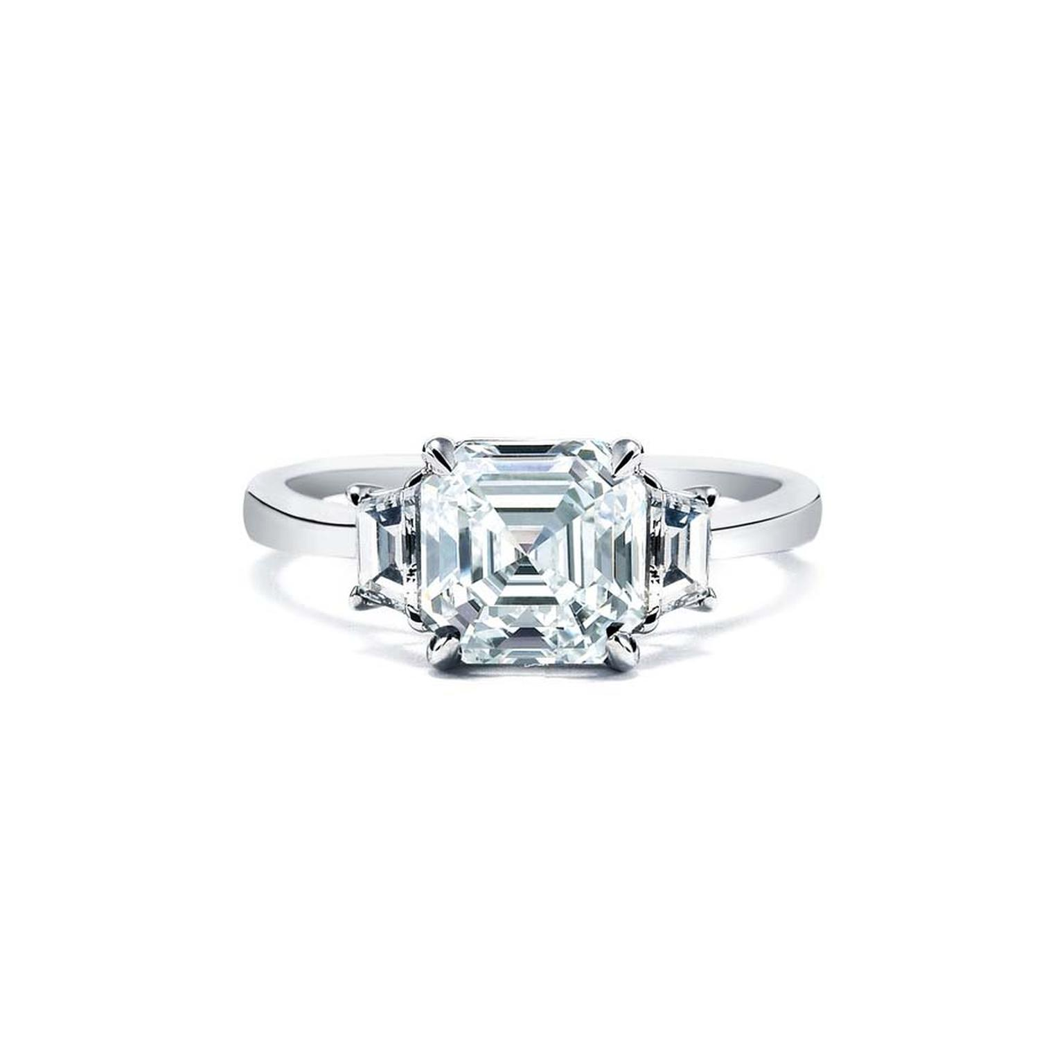 Royal Asscher cut diamond engagement ring in white gold, with accompanying shoulder set diamonds. Also available in platinum and yellow gold.