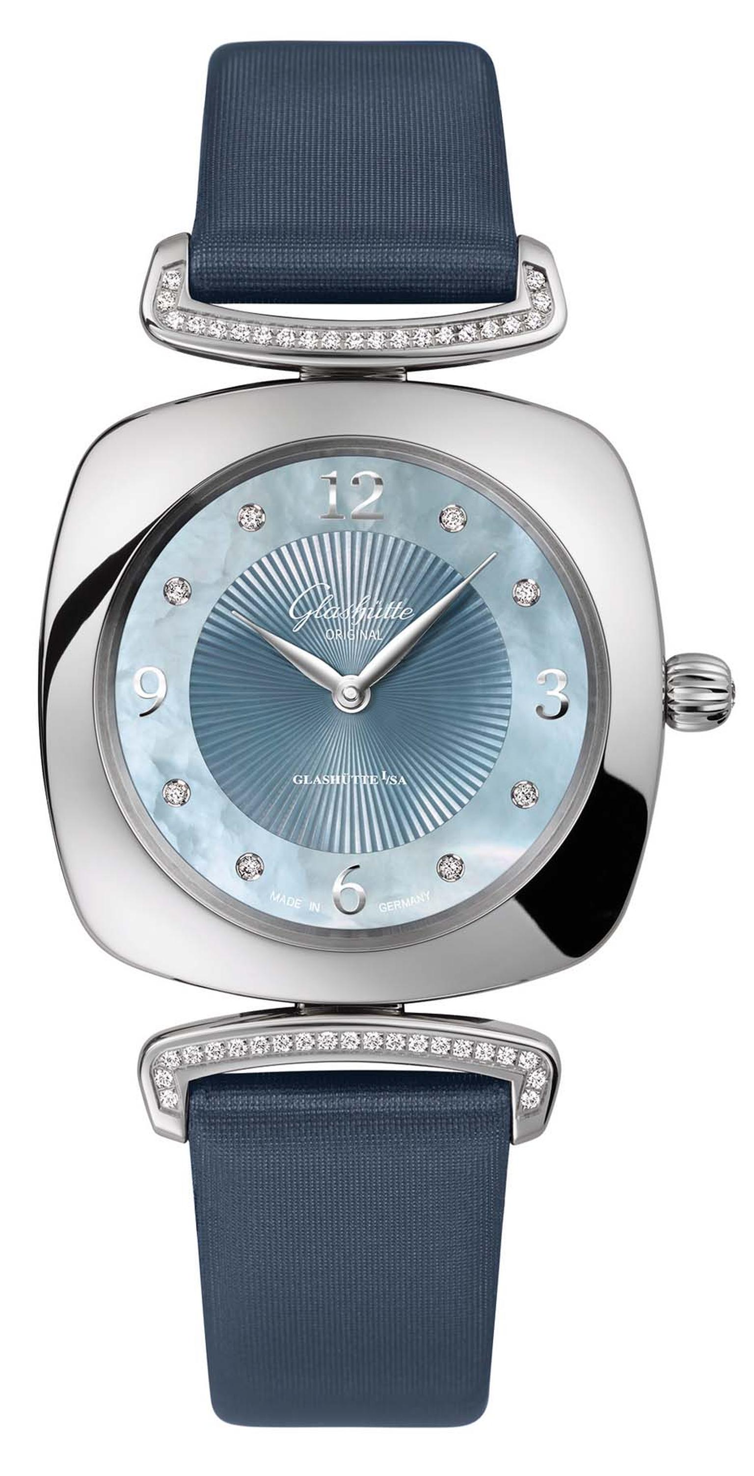 Glashütte Pavonina ladies' watch with a cushion-shaped 31 x 31mm stainless steel case is adorned with a lovely blue mother-of-pearl dial, diamond indices and diamond-set lugs.