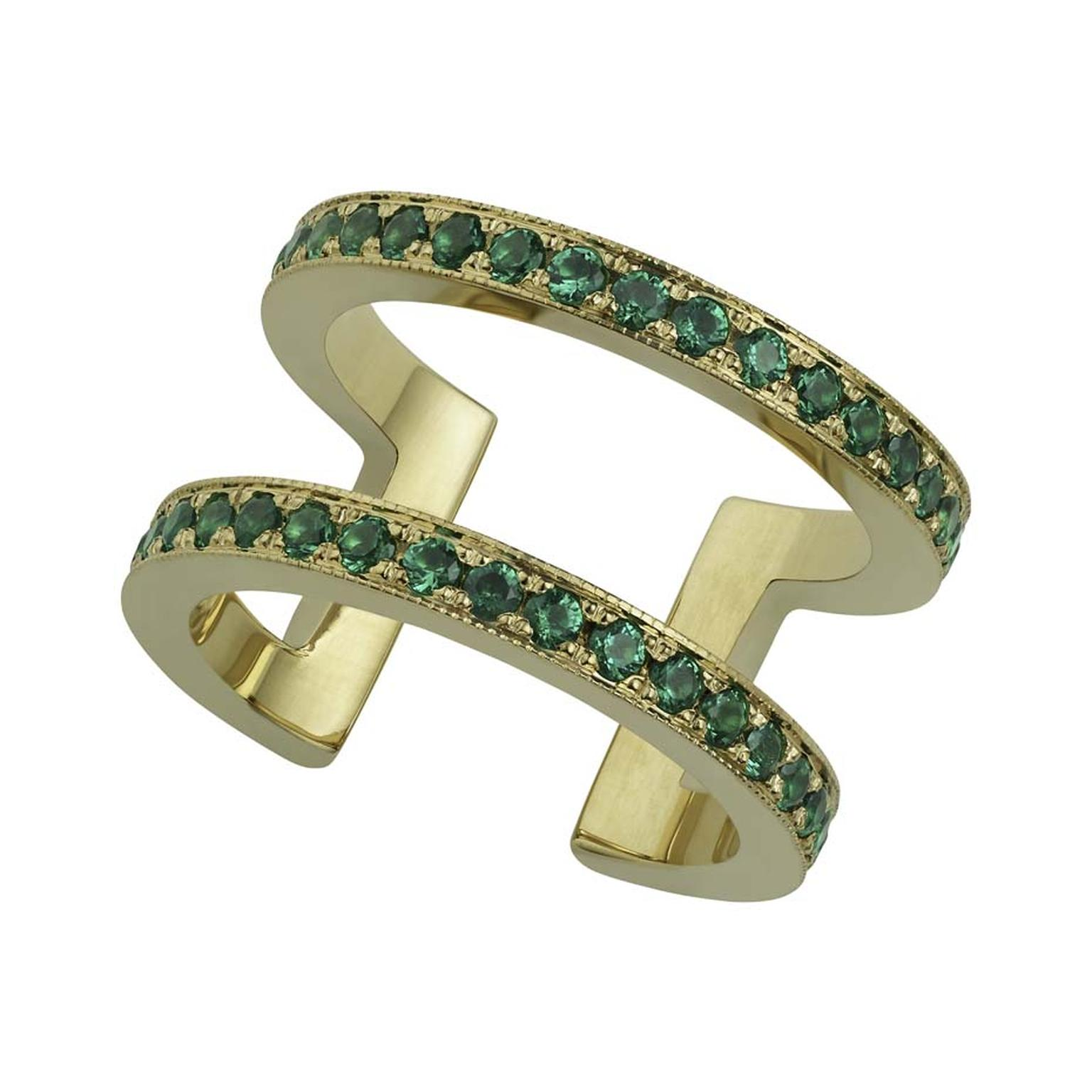Misahara Korali statement ring has a thicker yellow gold band, set with emeralds.