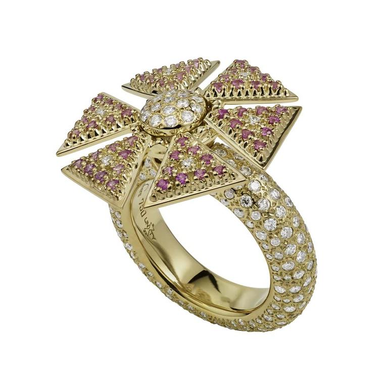 The Misahara Unity flower ring in yellow gold, set with pink sapphires and white diamonds. From the Sahara collection, the design enables the ring to spin.