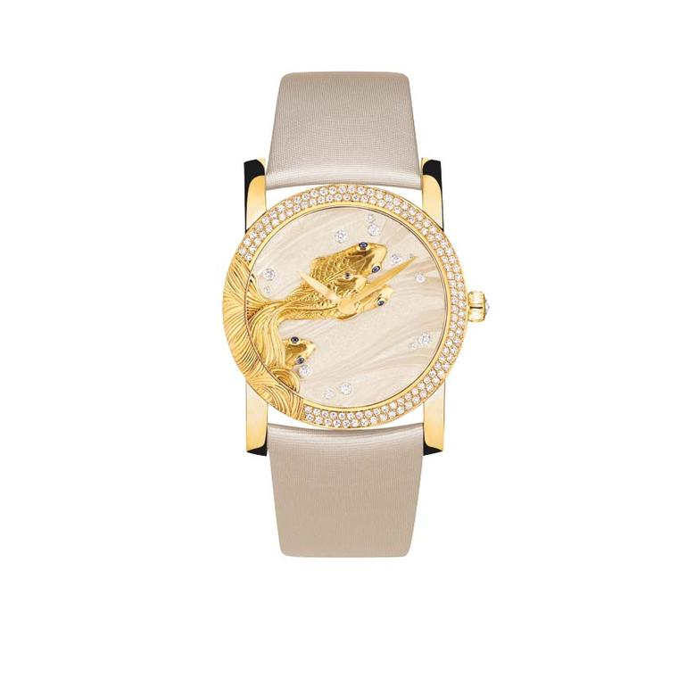 Chaumet watches included this fish-inspired dial in its Lumières d'Eau high jewellery collection. The 35mm yellow gold case with its diamond-set bezel comes to life as a shoal of hand-sculpted gold carp dart across the waves engraved on the white lacquer.