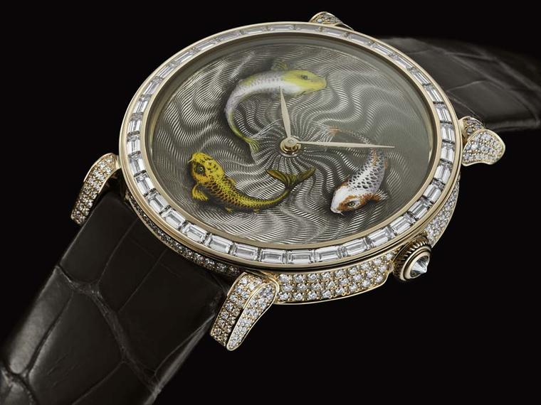 The DeLaneau Koi watch displays the incredible level of Grand Feu enamel painting executed at the brand's headquarters in Geneva. A unique piece, the three Koi fish swim against a swirling guilloché background and are trapped for eternity in a 42mm red go