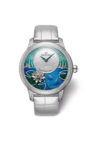 The Jaquet Droz Petite Heure Minute Carps watch paints a lovely Asian-inspired scene of Koi carp frolicking in the water with a lotus flower and bulrushes in the background. The skills of the artisans behind the exquisite enamelling and engraving work bri