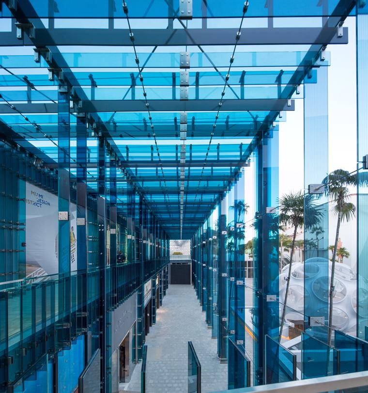 Glass walkways surround the many luxury brand boutiques that have chosen the Miami Design District as their home.