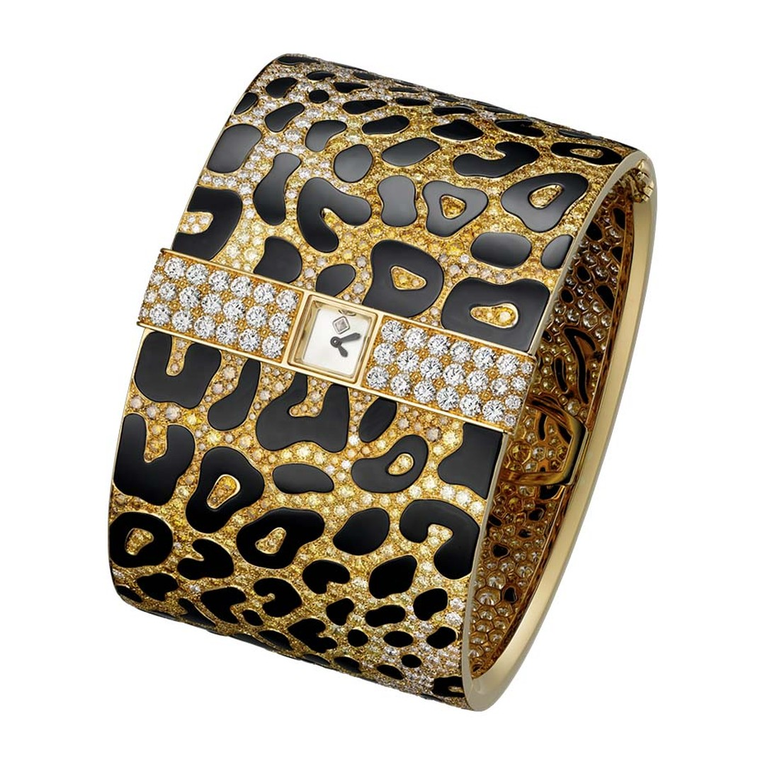 Cartier's Panthère Impériale high jewellery cuff is pavéd with light yellow, light orange, deep orange and brown brilliant-cut diamonds to create the panther's sumptuous coat. The secret watch is diminutive - no larger than the panther's eye - and discree