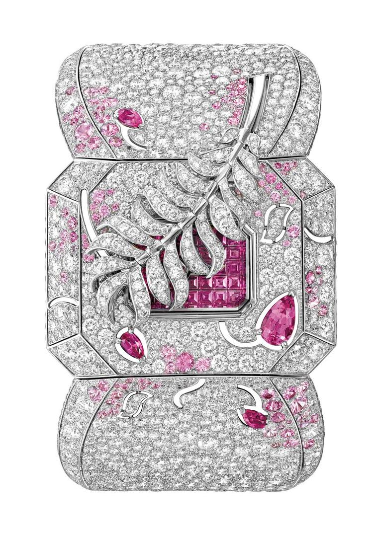 Chanel's Les Éternelles de Chanel Plume secret watch is a high jewellery ode to Coco Chanel's fascination with feathers. The white gold case is set with 2,319 snow-set diamonds and sapphires. To consult the time, touch the feather gently and watch the pin