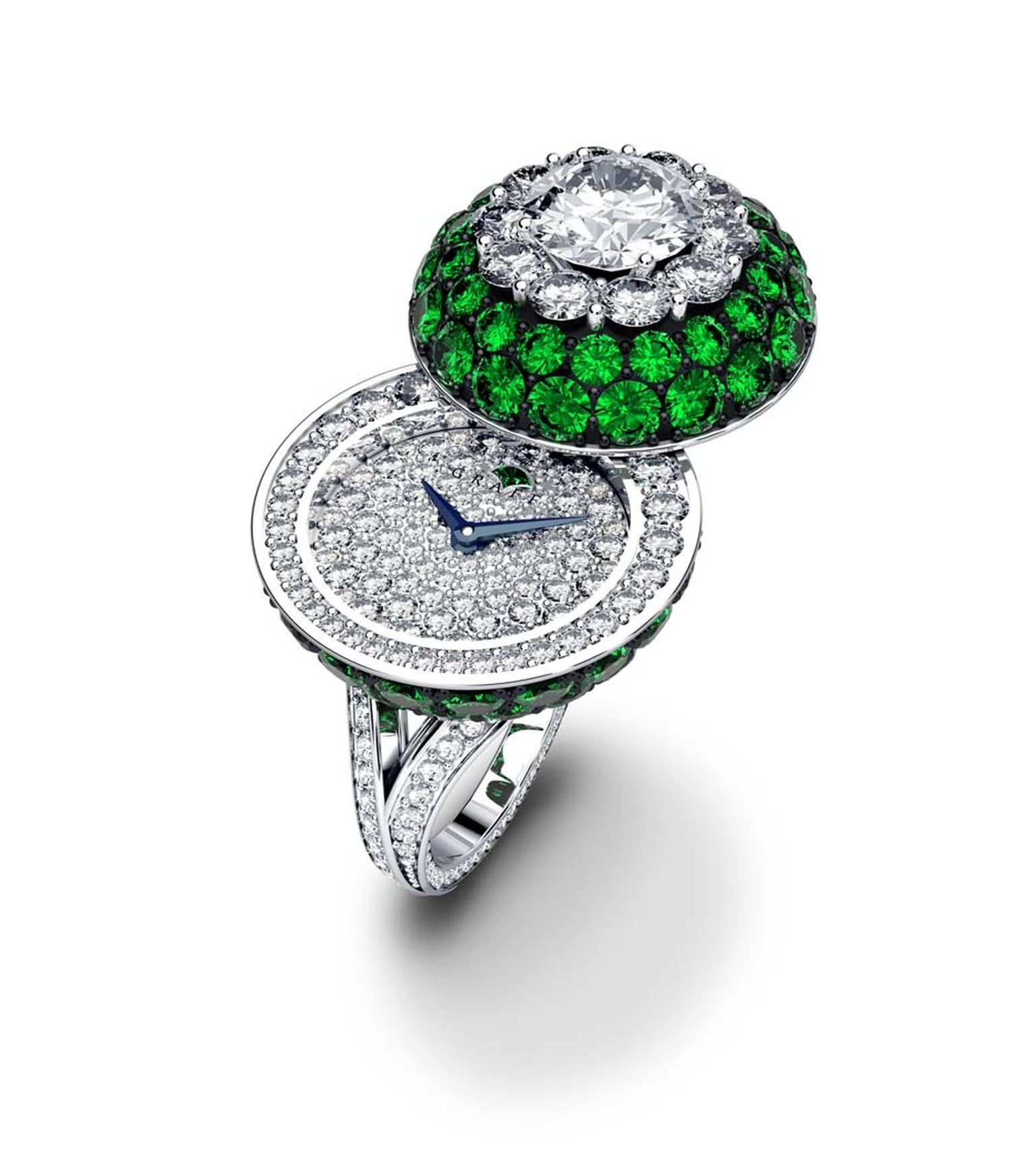 Graff Halo Secret Ring in white gold with diamonds and emeralds.