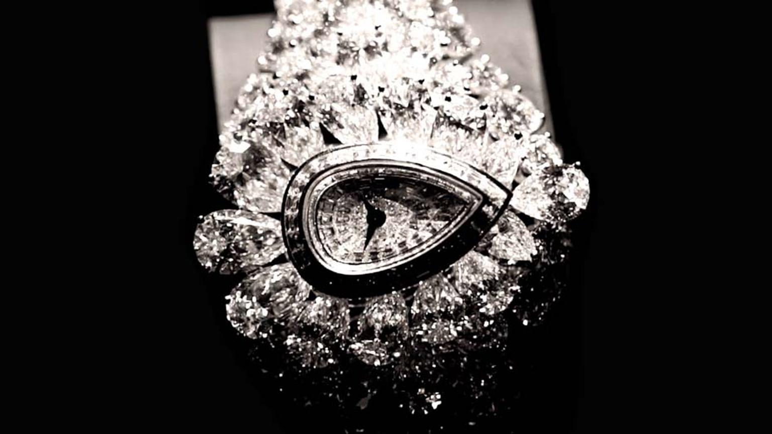 The transformable Graff Fascination watch, with its 152.96ct cluster of white diamonds, includes a rare 38.13 pear-shaped diamond (not shown here), which can be detached and placed in a special shank and worn as a ring. In yet another transformation, a di