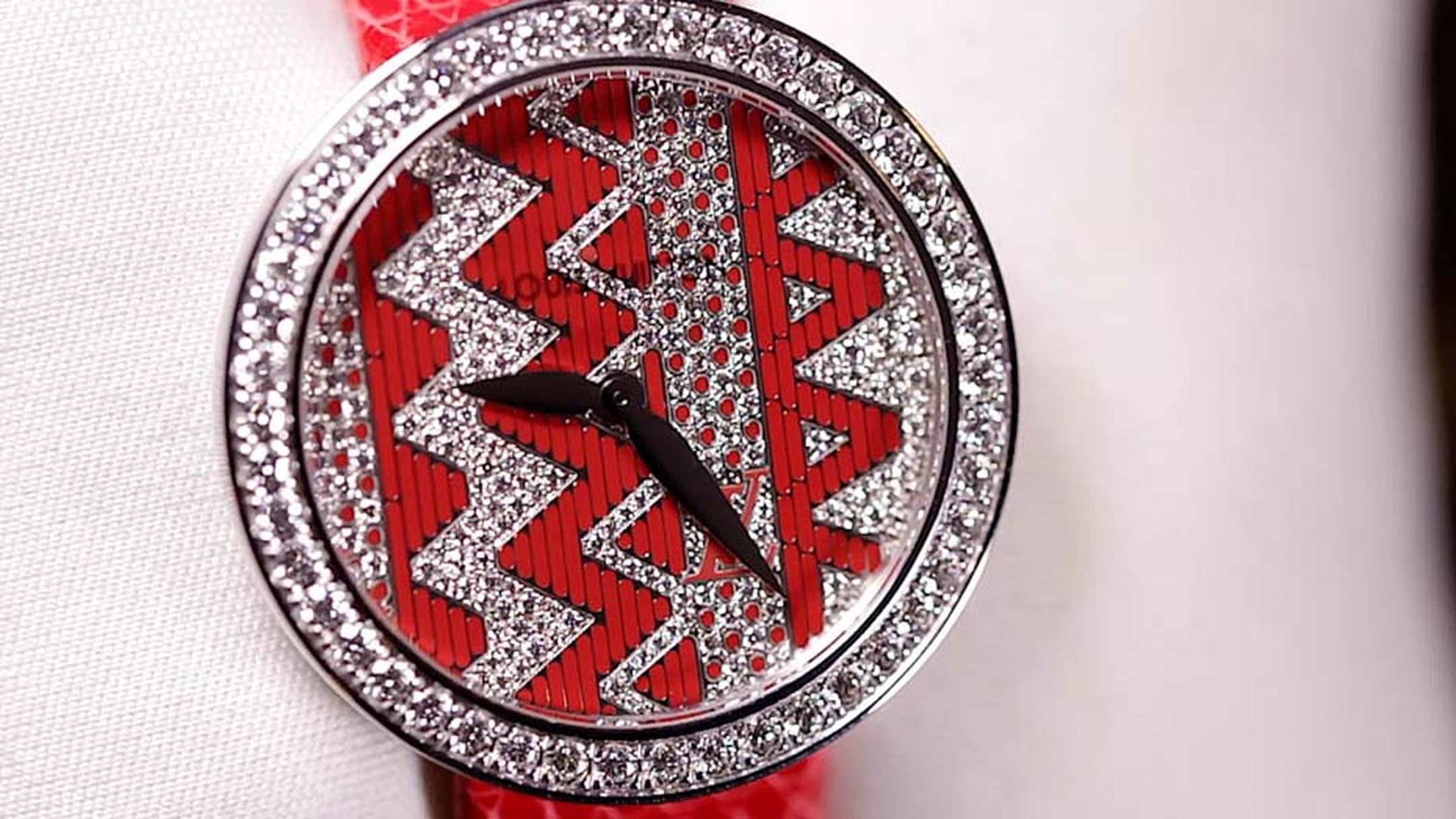 Louis Vuitton's new Chevron ladies' watch in red lacquer and diamonds was created under the guidance of creative director Nicolas Ghesquiere, whose Summer 2015 ready-to-wear collection incorporated the famous Monogram V.